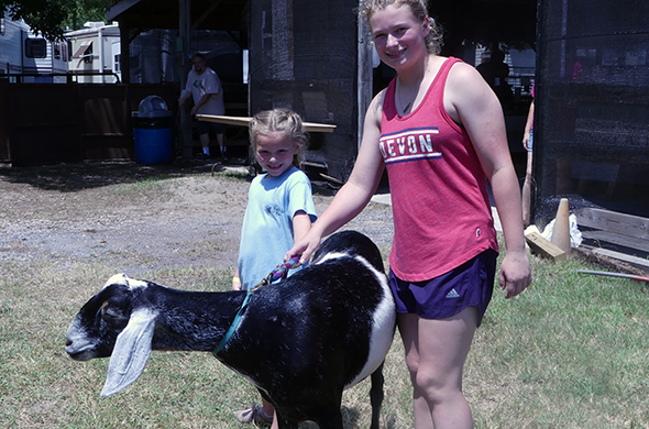 4-hers with a goat
